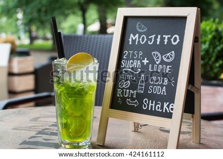Mojito Chalk lettering. Cocktail and recipe on the blackboard. - stock photo