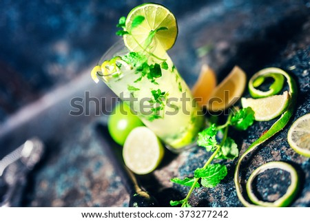 mojito cocktail details with lime garnish and bar details - stock photo