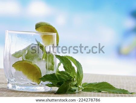 Mojito cocktail drink. Glasses with lime  ice, and leaf of mint - stock photo