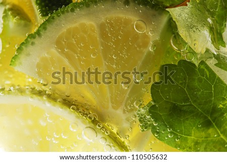 Mojito cocktail. lemon macro shot - stock photo