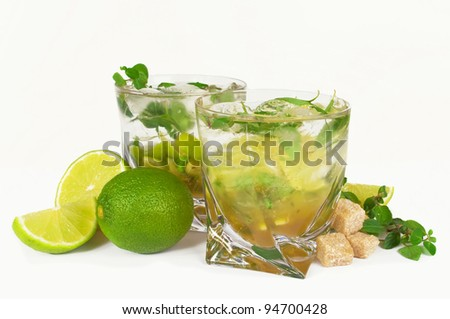 Mojito cocktail  limes and mint isolated on a white background - stock photo