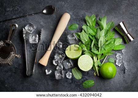Mojito cocktail making. Mint, lime, ice ingredients and bar utensils. Top view - stock photo