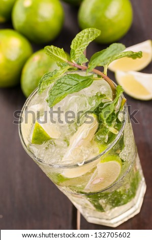 Mojito cocktail on a wooden table top view close up - stock photo