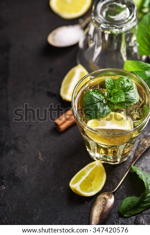 Mojito cocktail on dark table with copyspace. - stock photo