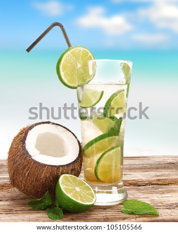 Mojito cocktail on the beach - stock photo