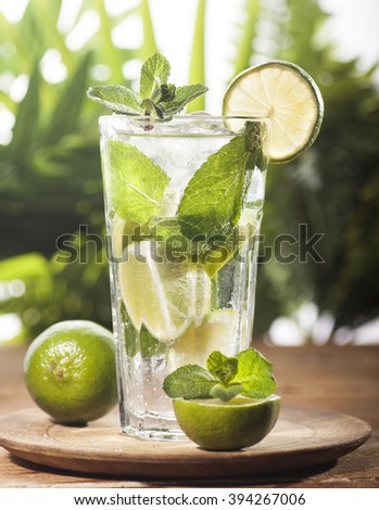 Mojito cocktail on tropical background