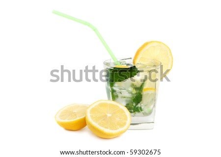 Mojito cocktail or iced tea with lemon, mint leaves and ice on white background