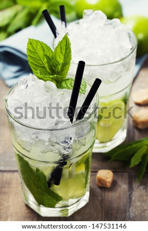 Mojito cocktail with ingredients on wooden background - stock photo