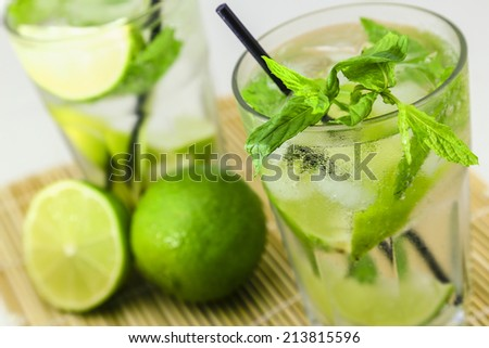 Mojito cocktail with limes and mint - stock photo