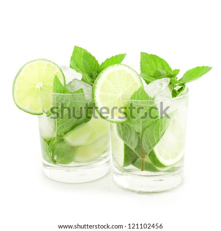 Mojito cocktails with mint leaf and lime slices isolated on white background