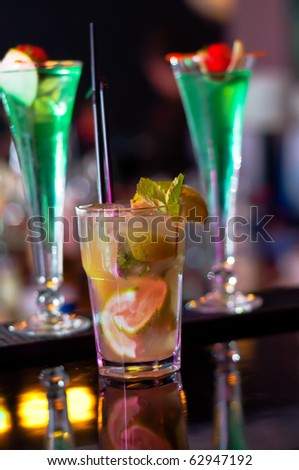 Mojito Drink between Cuba Libre drinks, served in a nightclub