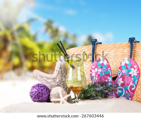 Mojito drink, Hat and flip-flops with tropical beach background, summer accessories - stock photo