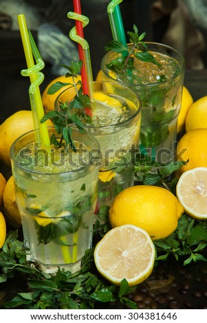 Mojito drink.Mojito with pieces of fruit. Fresh mojito with fruits. - stock photo