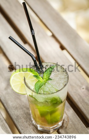 mojito drink on a garden table - stock photo