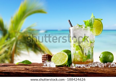 Mojito drink on wood with blur beach background - stock photo