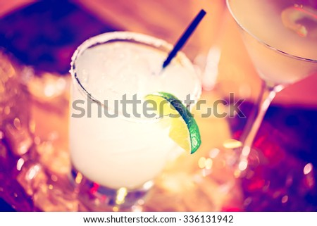 Mojito garnished with lime wedge at the bar. - stock photo