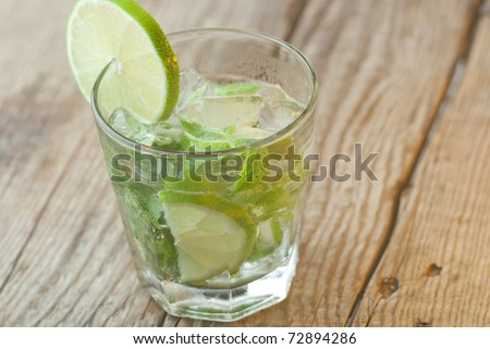 Mojito glass with wood background - stock photo