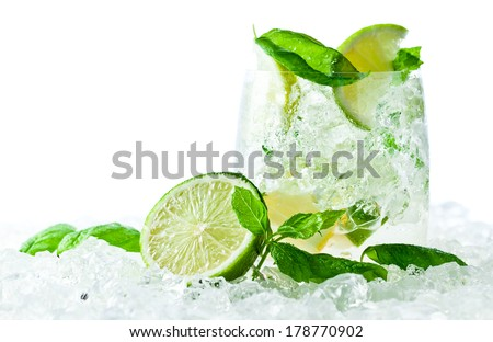 Mojito , lime pieces , leaves of mint with ice and rum , isolated on white - stock photo