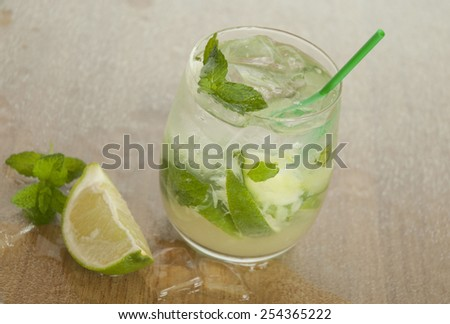 Mojito with ice, lime and mint - stock photo