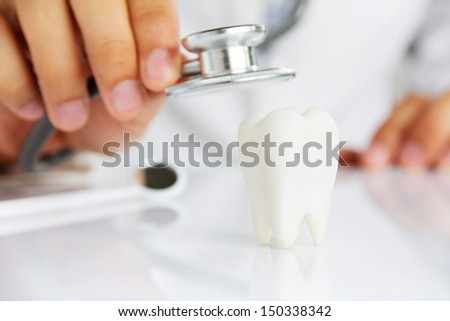 molar with dentist background ,dental concept  - stock photo
