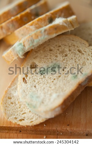 Mold on slices of white bread. Mould on food. Bread with mildew. Rotten food, bread. Macro perspective. Nobody. Shops, home, expire date.  - stock photo