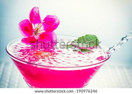 Molecular mixology - Cocktail with caviar and flower petals - stock photo