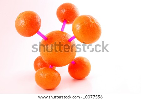 Molecular model made of orange - stock photo