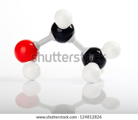 Molecule of ethanol, pure alcohol, molecular formula C2H5OH. Carbon represented by the black balls, oxygen by a red ball, Hydrogen by the white balls attached to the carbon or oxygen. - stock photo