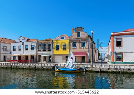 Moliceiro boat docked along the canal in Aveiro, Portugal