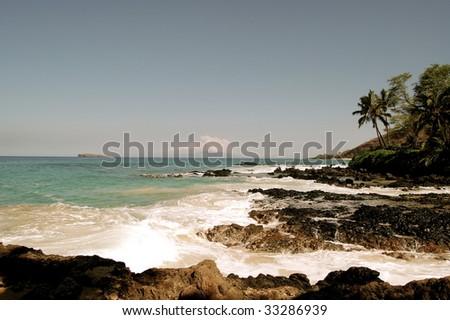 Molokini from Secret Beach on Maui - stock photo