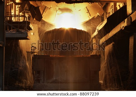 Molten hot steel is pouring - Industrial metallurgy - stock photo