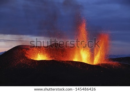 Molten lava erupts from Eyjafjallajokull Fimmvorduhals Iceland - stock photo