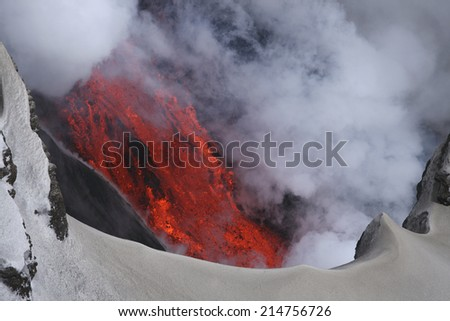 Molten lava flowing from Eyjafjallajokull Fimmvorduhals Iceland - stock photo