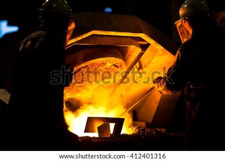 Molten metal. Aluminum foundry. Master alloys manufacturing - stock photo
