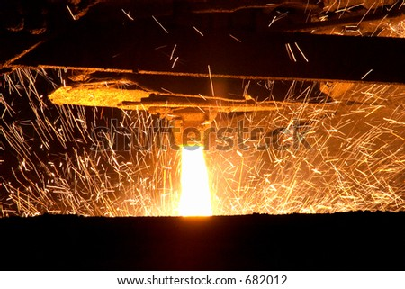 Molten steel pouring - stock photo