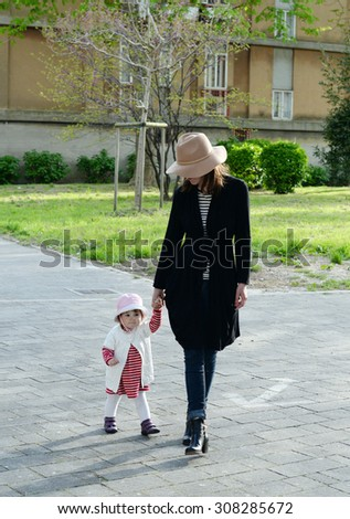 Mom and baby daughter in Venice, Italy - stock photo