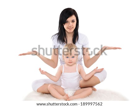 Mom and baby doing exercise, gymnastics, yoga, fitness and health - concept - stock photo