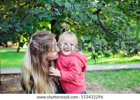 mom and baby in autumn park