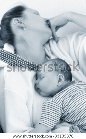 Mom and baby sleep tired - stock photo