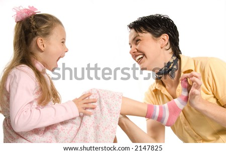 mom and daghter having fun with dress-up - stock photo