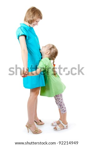 Mom and daughter are hugging, white background - stock photo