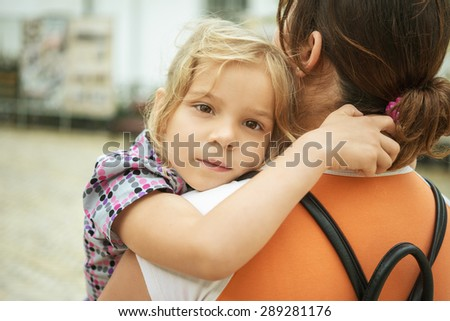 Mom and daughter close-up. - stock photo
