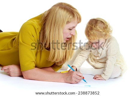 Mom and daughter drawing lying on the floor. Isolated on white background studio photo.