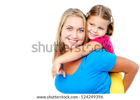 Mom and daughter having fun. Its piggy ride time - stock photo