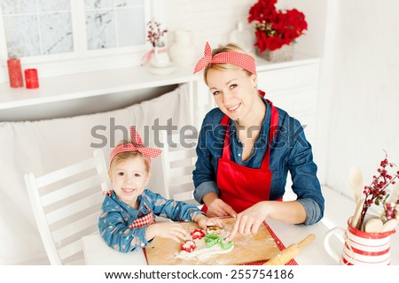 Mom and daughter in the kitchen baking cookies