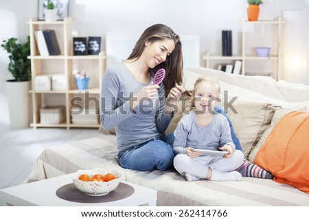 Mom and daughter in the living room  - stock photo