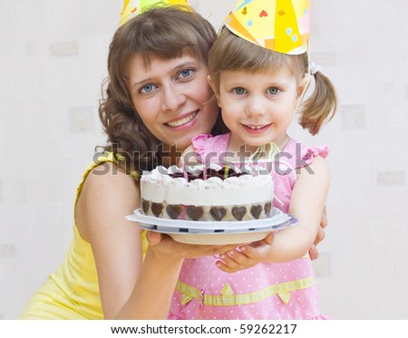 Mom and daughter stretch cake guests - stock photo