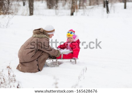 mom and doughtier outdoors in winter - stock photo
