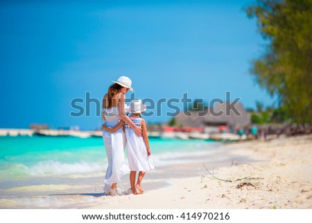 Mom and girl during beach vacation
