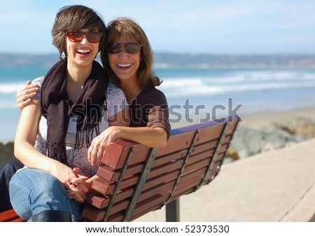 Mom and Grown Daughter Bonding at the Beach - stock photo